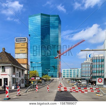 Zurich, Switzerland - 4 April, 2016: road works on Geroldstrasse street, Prime Tower building in the background. Zurich is the largest city in Switzerland and the capital of the Swiss canton of Zurich.