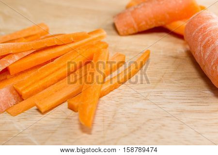 Carrot batons Raw carrots being sliced into batons for a stir fry