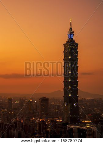 Sunset of cityscape nightlife view of Taipei. Taiwan city skyline at twilight time public scene from view point at Elephant Mountain Hiking Trail.