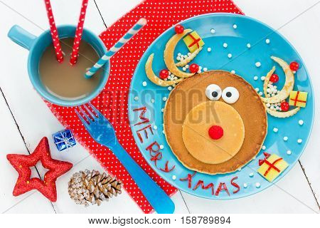 Christmas fun food for kids - santa reindeer pancake for creative and healthy breakfast or brunch on holiday