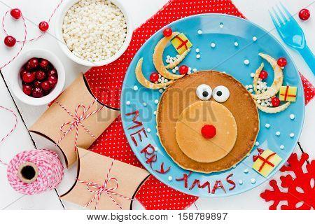 Reindeer pancake - Creative food art breakfast for kids on Christmas or New Year. Christmas food New Year food Kids meal