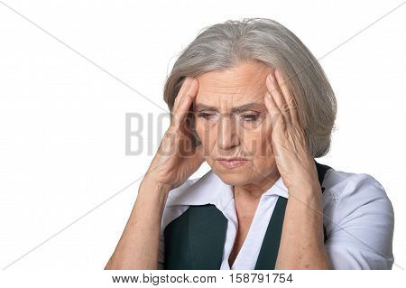 Portrait of senior woman has headache isolated on white background