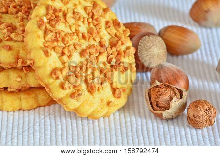 Shortbread biscuits topped with chopped hazelnuts macro
