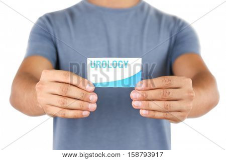 Man holding business card. Urology concept