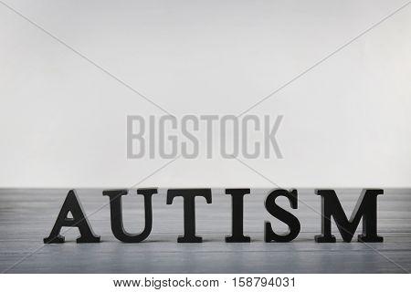 Autism word on light background