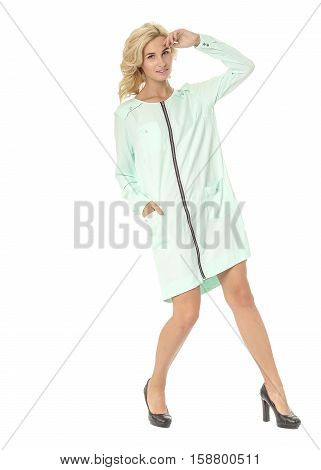 Portrait Of Flirtatious Woman In Turquoise Dress Isolated On White
