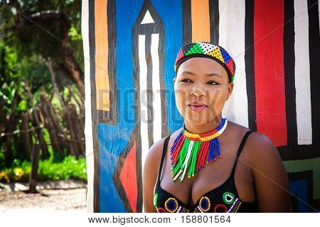 Lesedi Cultural Village, SOUTH AFRICA - 4 November 2016: Young Zulu woman in colourful traditional bead work costume.