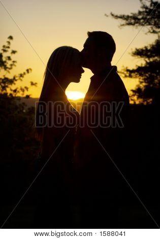 Couple Under A Golden Sunset