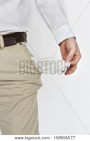 Male Shows Empty Pockets Moneyless Concept
