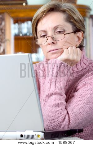 Middleaged Woman Using Laptop