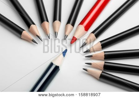 one blue pencil against all black with red leader. Abstract gay discrimination