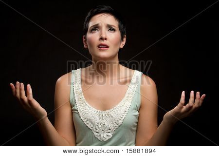 Young sad christian woman praying