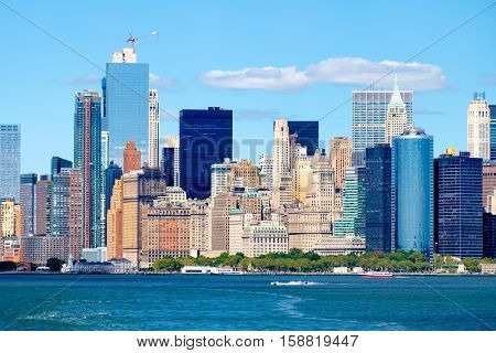 The Lower Manhattan skyline iand Battery Park n New York City seen from the ocean on a sunny summer day