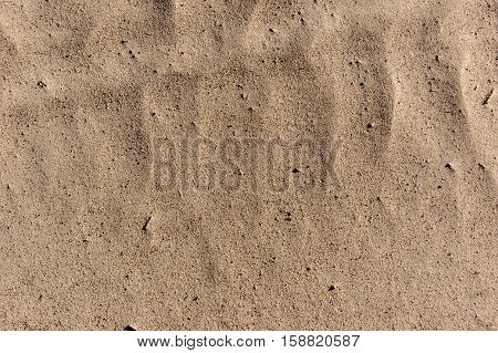 Sandy beach background summer theme. Sand texture. Macro shot of sand with weaves.