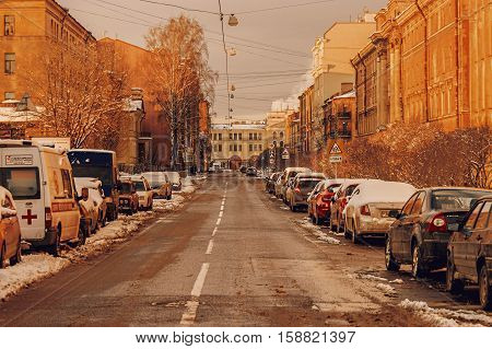 St Petersburg Russia 24 of Feb. 2016: Street with prked cars coverd with snow after night snowfall.
