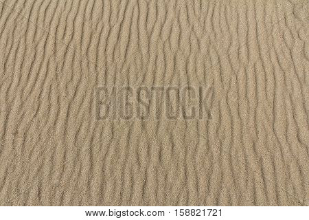 Sand pattern at the beach with selective focus