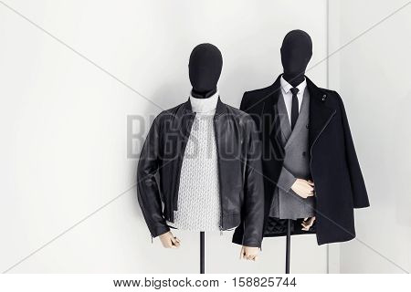 male models with black clothes in show window