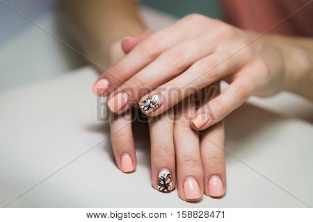 Hands with two week manicure. Before hardware manicure in salon
