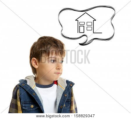 Sad little boy dreaming of home, white background. Adoption, custody and childcare concept.