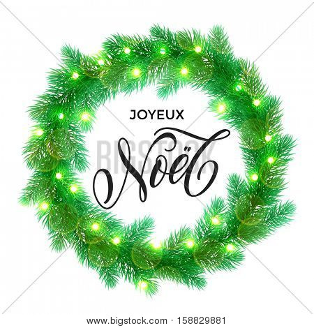 French Merry Christmas text. Joyeux Noel calligraphy greeting. Decorative wreath of Christmas lights garland decoration. France Christmas holiday tree wreath of of pine, fir, spruce branches