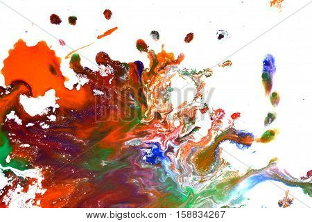 Isolated large patches spots blots of splash of mixed colors on a white background. Divorces and paint drips red, orange, yellow, blue blurred abstract background on a white paper background surface
