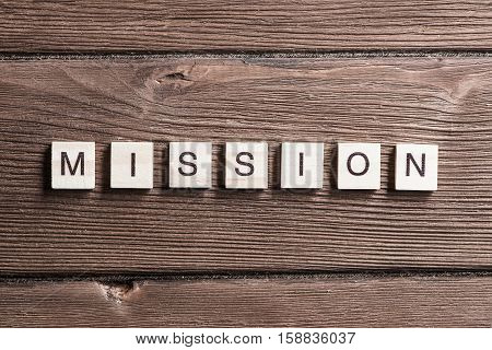 Business mission word collected of elements of wooden elements with the letters