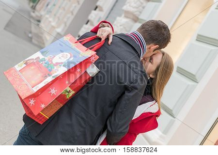 Romantic Couple Exchanging Christmas Gifts. Romantic Surprise For Christmas.