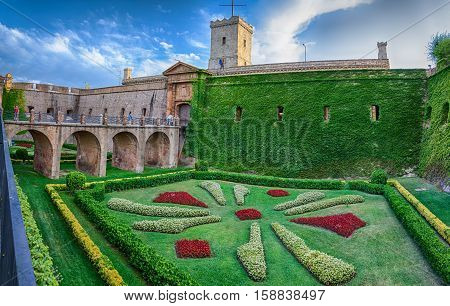 Colorful green yard of Montjuic castle in Barcelona, summer Spain