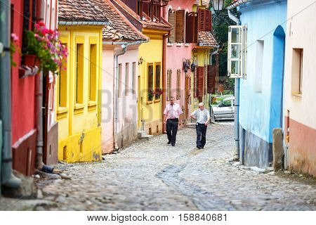 Sighisoara, Romania - July 17: Walking In Historic Town Sighisoara On July 17, 2014. City In Which W