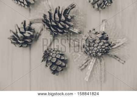 Christmas background with silver bowknots and white cones.New Year.Black and white,toned