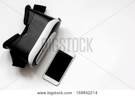 virtual reality glasses with smartphone on white background top view