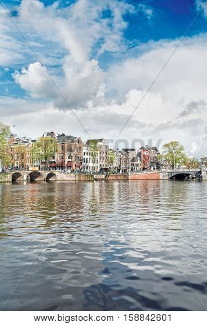 embankment of Amstel canal in Amsterdam, Holland