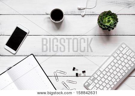 male work desktop wooden with blank open notebook top view