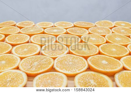 Fresh juicy orange round sliced slices closeup, background