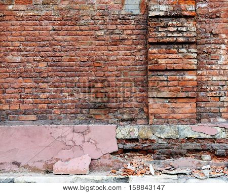 Broken old Bricklaying wall Fragment From red bricks and damaged plaster for Background