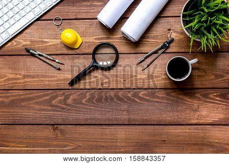Engineer wooden working desktop with tools top view