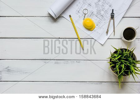 engineering tools on wooden table with drawings apartments top view.