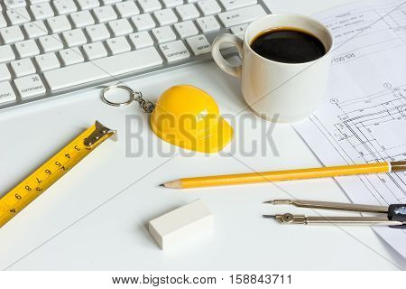 engineering tools on white background with drawings apartments top view.