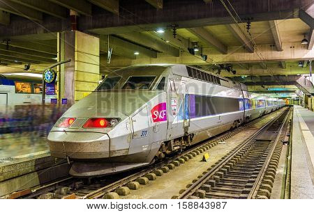 Paris, France - October 9, 2016: TGV Atlantique trainset at Montparnasse railway station. Paris-Montparnasse station provides connections to Bordeaux, Tours, Rennes and other cities in the west and south-west of France
