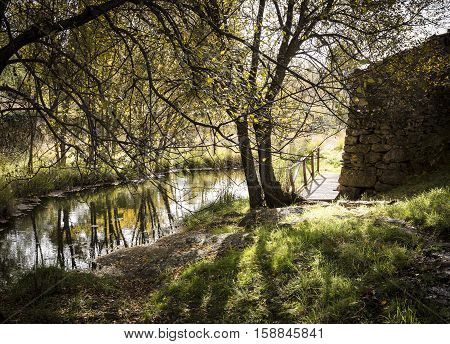ancient watermill and a small lake in Autumn in Penha Garcia, Idanha-a-Nova, district of Castelo Branco, Portugal