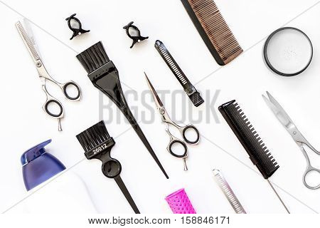 hairdresser tools on white background top view.