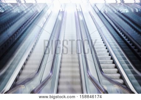 Escalator blurred with motion, high key image