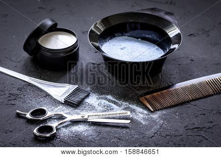 hair dye with brush on dark background close up