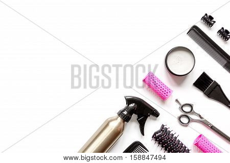 preparations for styling hair on white background top view.