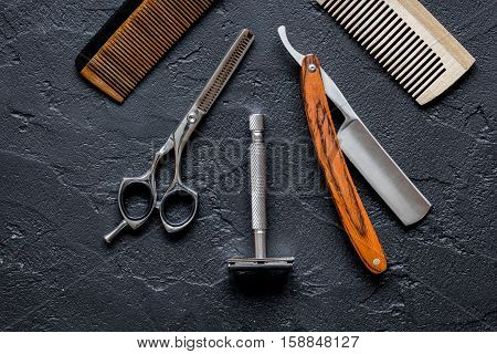 Tools for cutting beard barbershop top view on dark background