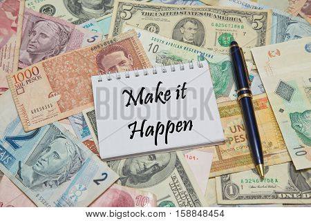 Notebook page with text MAKE IT HAPPEN, background from different world Currencies