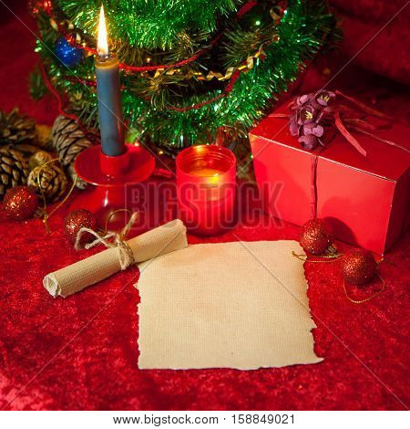 Christmas Tree With Paper And Burning Candle