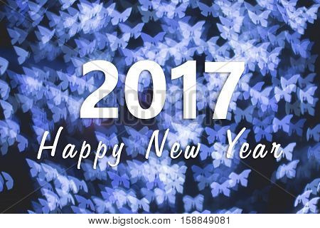 2017 Happy New Year background with blue butterfly bokeh