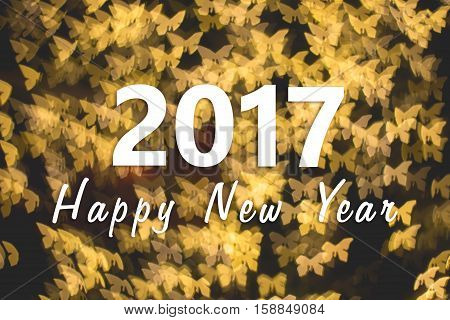 2017 Happy New Year background with golden butterfly bokeh
