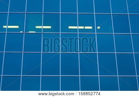 blue building all glass square patern with neon lights